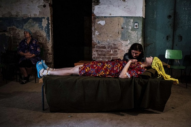 Photographer Dimitar Dilkoff continued his strong reportage from Ukraine this week. Here, a woman holds the hand of her sick friend in the basement of Kalinina hospital after shelling in Donetsk Dimitar Dilkoff/AFP