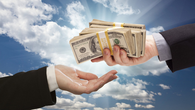 Handing Over Cash with Dramatic Clouds and Sky Background.